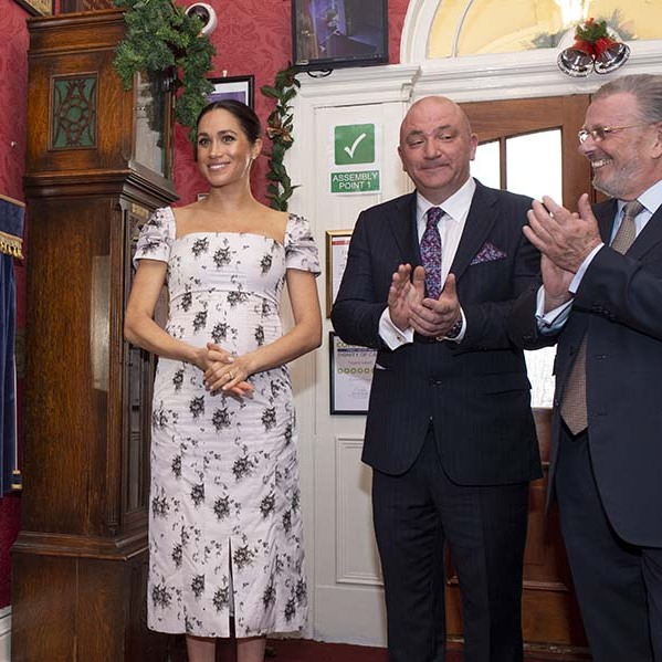 A pregnant Duchess of Sussex beamed in a floral frock from <a href=/tags/0/brock-collection><strong>Brock Collection</strong></a> at Brinsworth House in December 2018.