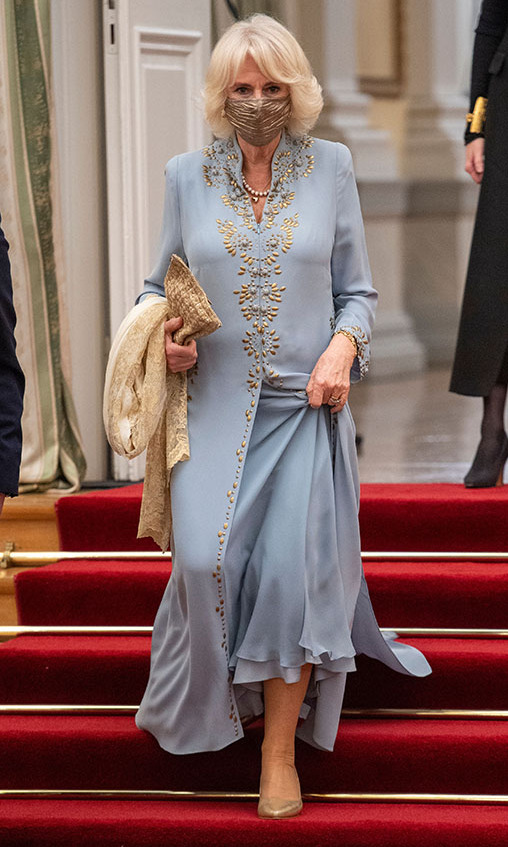 The Duchess of Cornwall stepped out in style in an embroidered duck egg blue dress and coat during her and Prince Charles's two-day royal tour of Greece in March 2021.