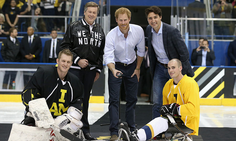 Prince Harry drops the puck next to Prime Minister Justin Trudeau at the start of a sledge-hockey match in Toronto in May 2016 as Harry launched the 2017 Toronto Invictus Games. Photo: © Chris Jackson/Getty Images
