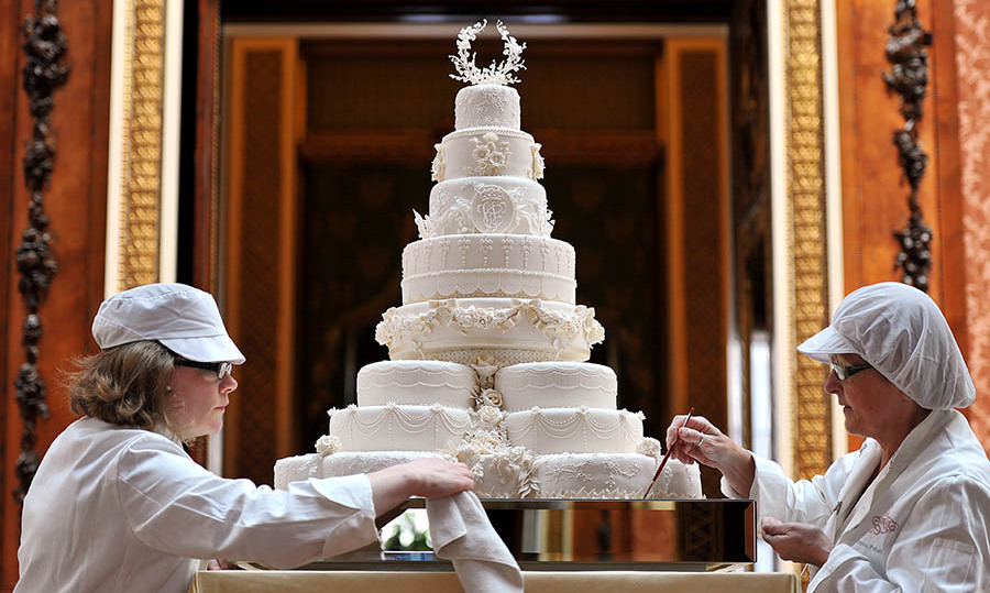 The final touches being applied to the magnificent wedding cake! Photo: © JOHN STILLWELL/AFP via Getty Images