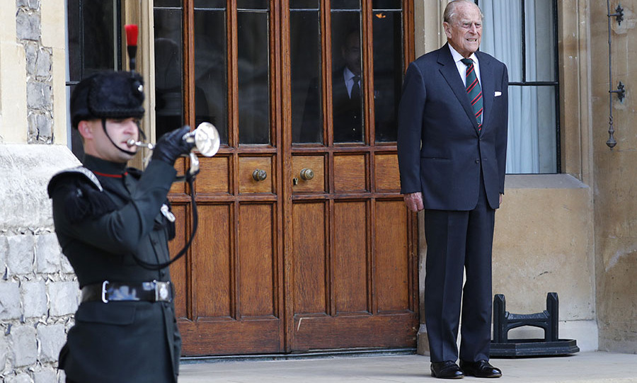 In one of his final public appearances, the 99-year-old stayed true to his classic style with a crisp navy suit and striped tie. 