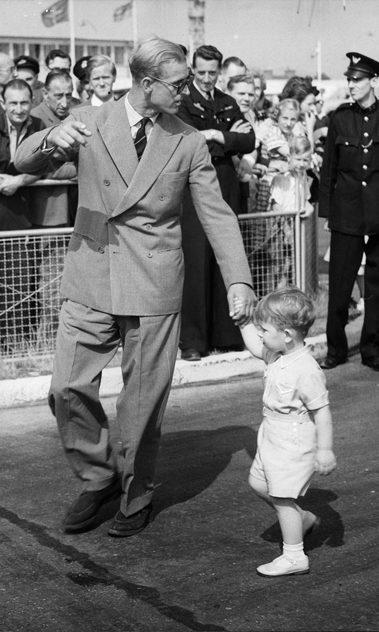 The Duke of Edinburgh captivated as he disembarked a plane in July 1951 in a double-breasted suit and shades.