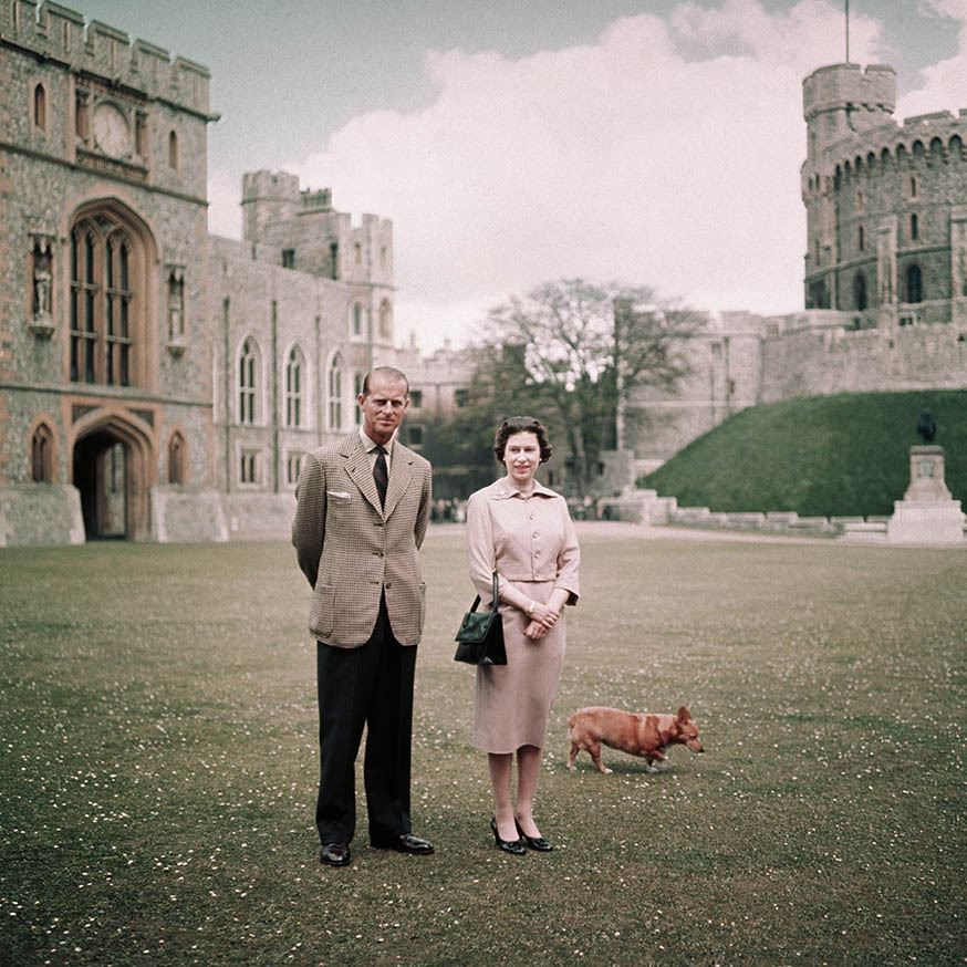 In 1959 at Windsor Castle, the duke and Her Majesty exuded polish in neutral ensembles. 