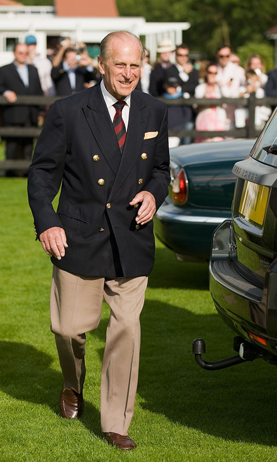 The father of four always showcased impeccable tailoring. This black jacket with gold buttons, his signature striped tie and beige slacks was another timelessly elegant example from the Guards Polo Club in June 2009.