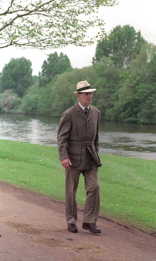 Dressed-down ensembles for the royal retained their dapper and polished air. See this belted jacket and panama hat the duke donned for a walk by the River Thames at Windsor Castle in May 1997.