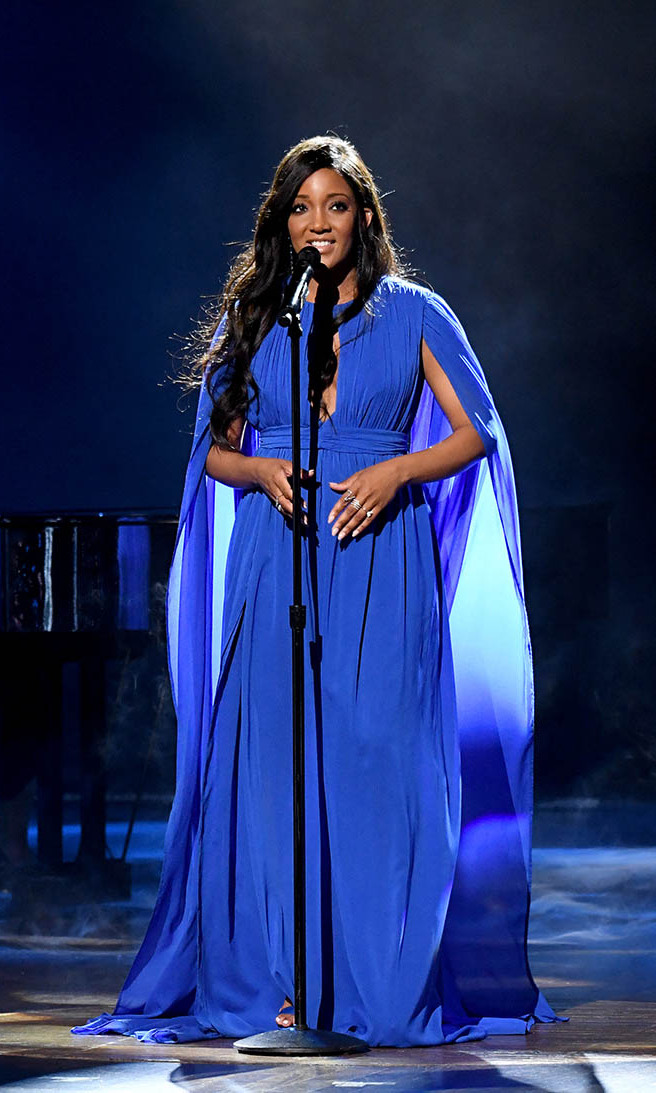 "ACM co-host <a href=/tags/0/mickey-guyton><strong>Mickey Guyton</strong></a> looked so dreamy in a flowing blue gown as she performed ""Hold On.""