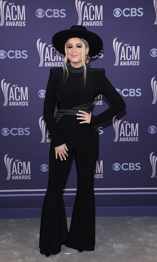 <strong>Gabby Barrett</strong> wore all black, including flares and a wide-brimmed hat.