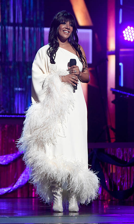 This feathered white ensemble was so ethereal on Mickey Guyton.