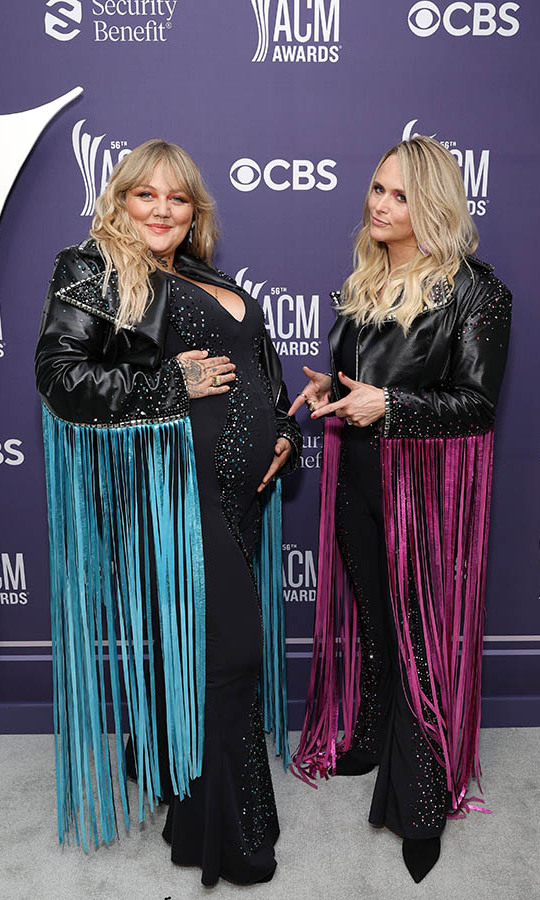 <a href=/tags/0/miranda-lambert><strong>Miranda Lambert</strong></a> highlighted <a href=/tags/0/elle-king><strong>Elle King</strong></a>'s baby bump as the two posed in coordinating fringed jackets backstage.
