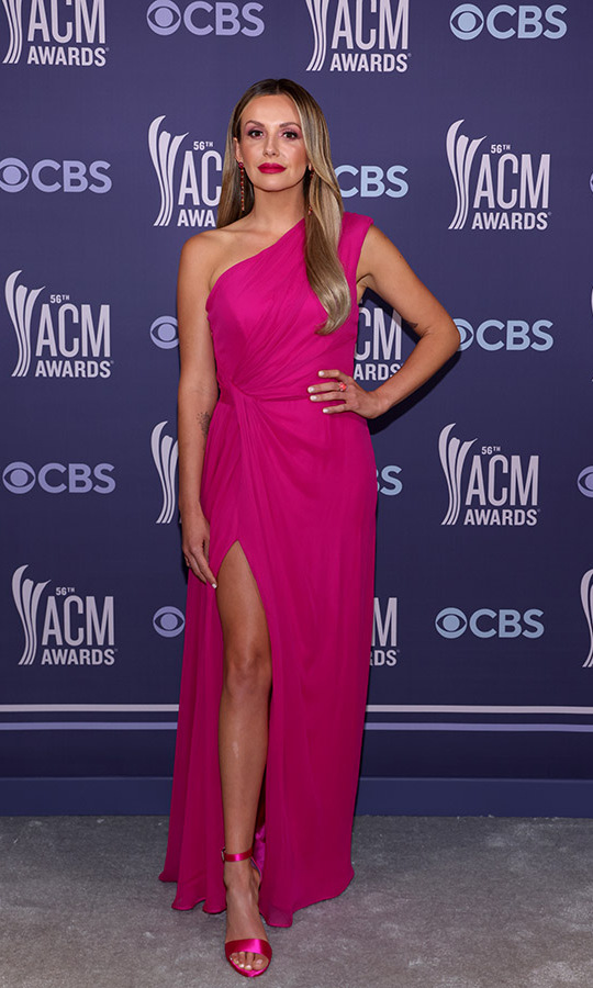 <strong>Carly Pearce</strong> stunned in hot pink from head to toe. She was in a <a href=/tags/0/Monique-Lhuillier><strong>Monique Lhuillier</strong></a> one-shouldered gown and <strong>Anabela Chan</strong> jewels.