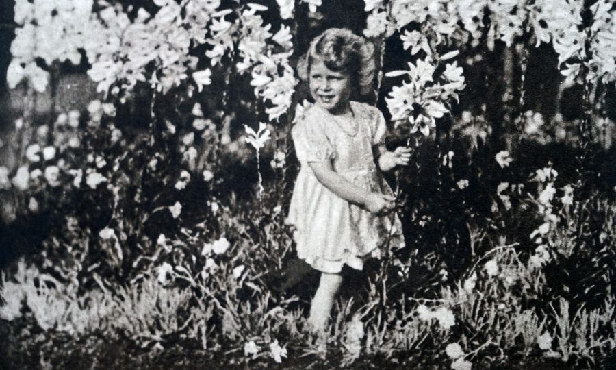 This incredible black-and-white shot of <a href=/tags/0/queen-elizabeth-ii><strong>the Queen</strong></a>, when she was Princess Elizabeth, highlights how she has always loved flowers.