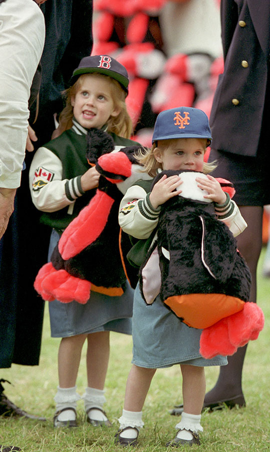 <a href=/tags/0/princess-eugenie><strong>Princess Eugenie</strong></a> and her big sister <a href=/tags/0/princess-beatrice><strong>Princess Beatrice</strong></a> looked cool in their caps and jackets as they snuggled up to their plush toys at The Royal Windsor Horse Show in May 1993.
