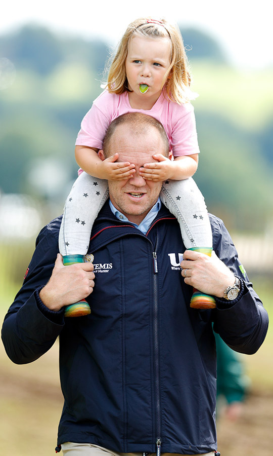 Where'd you go? <a href=/tags/0/mike-tindall><strong>Mike Tindall</strong></a> carried daughter <a href=/tags/0/mia-tindall><strong>Mia Tindall</strong></a> on his shoulders as she sucked on a candy at the Festival of British Eventing at Gatcombe Park on Aug. 4, 2017. 