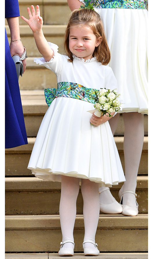 <a href=/tags/0/princess-charlotte><strong>Princess Charlotte</strong></a> sweetly waved to the crowds when she was part of the wedding party for the royal wedding of Princess Eugenie and <a href=/tags/0/jack-brooksbank><strong>Jack Brooksbank</strong></a> at St George's Chapel on Oct. 12, 2018 in Windsor. <p>Photo: &copy; Pool/Max Mumby/Getty Images