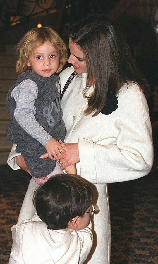 <a href=/tags/0/queen-rania><strong>Queen Rania</strong></a> of Jordan carries three-year-old daughter <a href=/tags/0/princess-iman><strong>Princess Iman</strong></a> in December 1999.