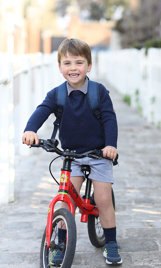 <a href=/tags/0/prince-louis><strong>Prince Louis</strong></a> looked ecstatic on his red bike on his first day of nursery school at the Willcocks Nursery School in London in April 2021.