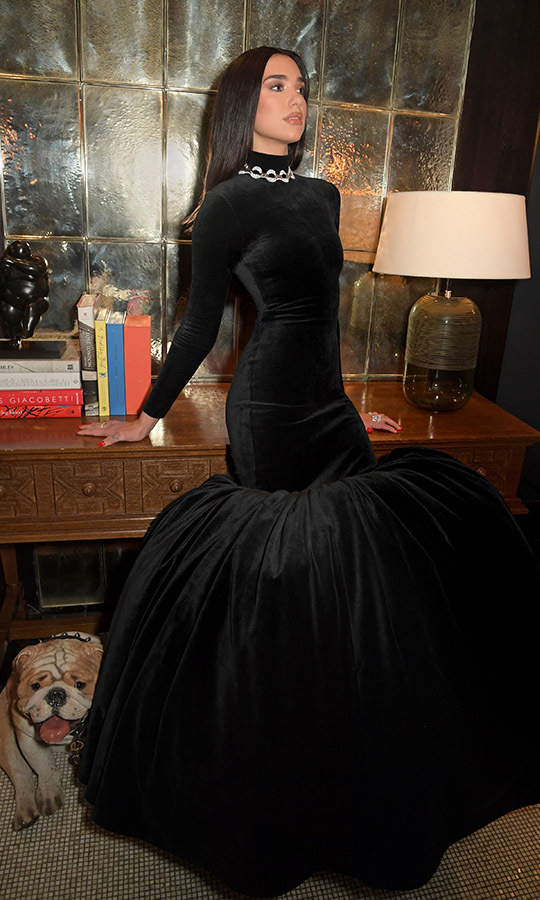 The singer switched up her look for a dramatic black gown with full skirt.