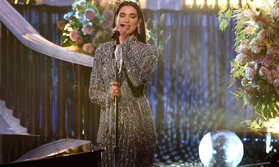 <a href=/tags/0/dua-lipa><strong>Dua Lipa</strong></a> performed in a silver gown surrounded by a gorgeous set.
