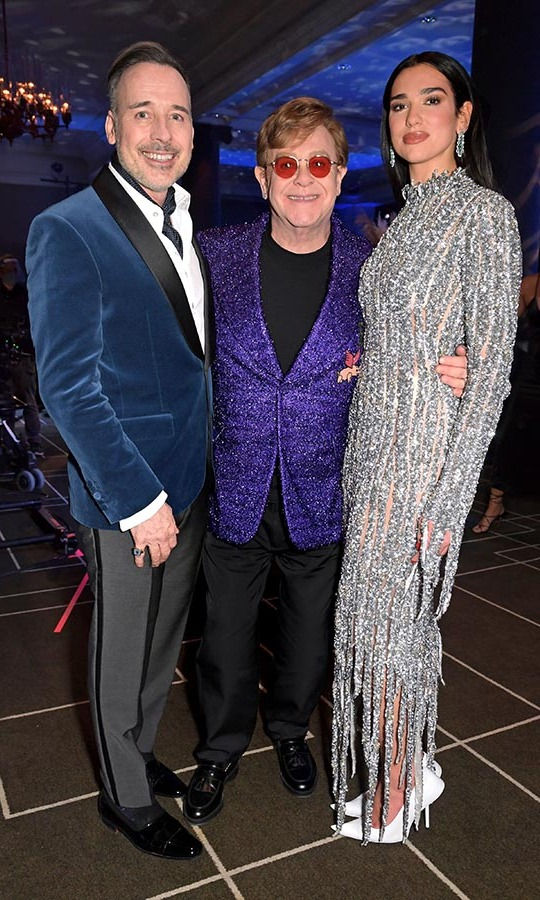 David, Elton and Dua Lipa struck a pose in their snazzy outfits.