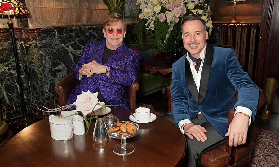 The singer and husband <a href=/tags/0/David-Furnish><strong>David Furnish</strong></a> had a relaxing moment with tea and biscuits.