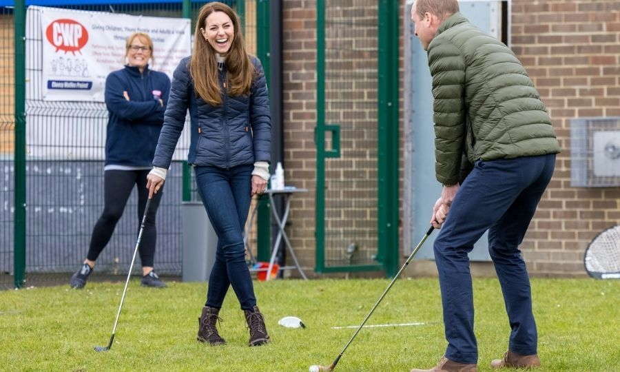 ... and Kate couldn't contain herself. To be fair, he is using a child's golf club!