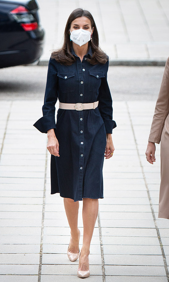 Queen Letizia put an elegant finish on a dark denim shirtdress for a meeting on April 16 in Madrid.