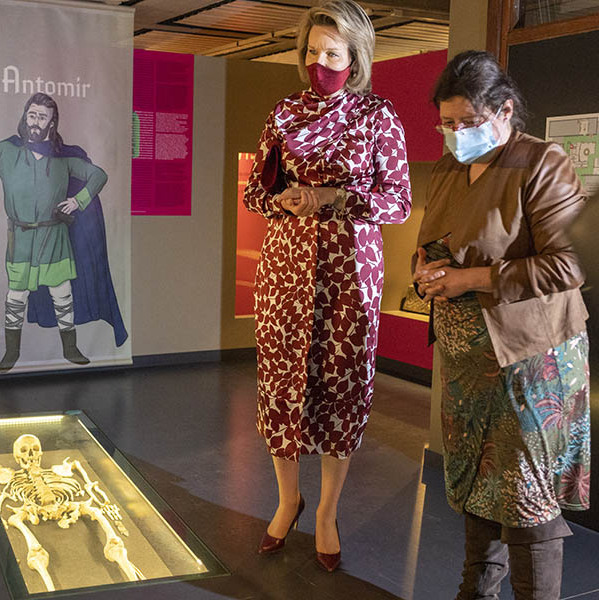 <a href=/tags/0/queen-mathilde><strong>Queen Mathilde</strong></a> coordinated her face mask with her patterned dress while taking in an exhibition at the Royal Museum of Mariemont on April 27.