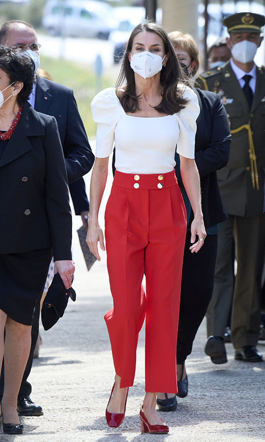 <a href=/tags/0/queen-letizia><strong>Queen Letizia</strong></a>'s red and white ensemble at the VI Educational Congress of Rare Diseases at the CPEIBas Guadalentin on April 30, 2021 in Totana had a nautical feel. 