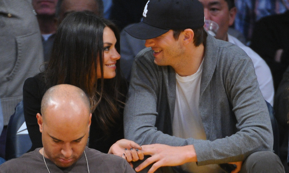 The couple are reportedly planning to marry but are waiting until Ashton's divorce from ex-wife Demi Moore is finalized. @ Getty Images