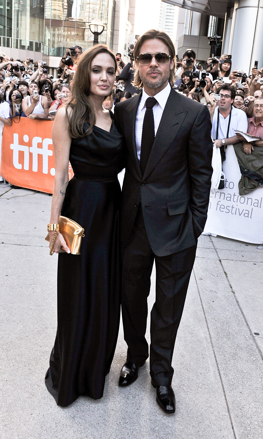 "Angelina Jolie and Brad Pitt arrive to the ""Moneyball"" premiere at Roy Thomson Hall during the 2011 Toronto International Film Festival."