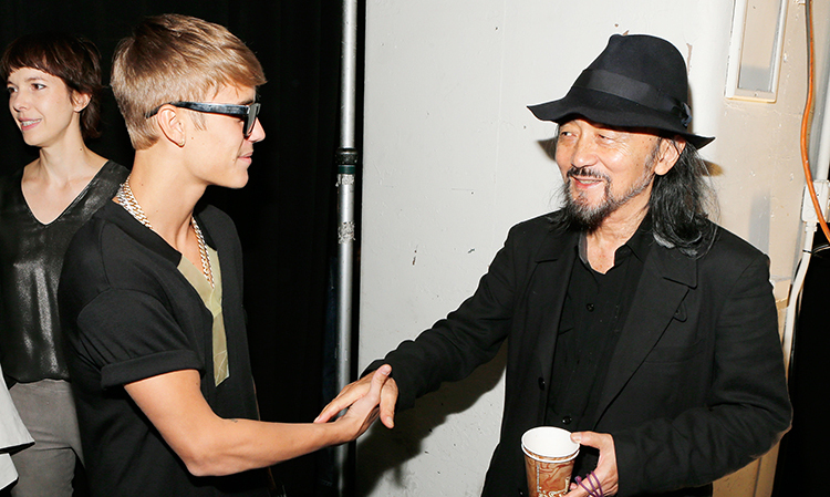 Justin Bieber (L) and fashion designer Yohji Yamamoto meet backstage at the Y-3 Spring/Summer 2014 show during Mercedes-Benz Fashion Week on September 8, 2013 in New York City.