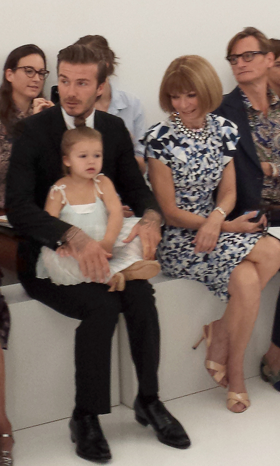 Soccer star David Beckham with daughter Harper and celebrity editor of Vogue Anna Wintour (R) watch as designer wife Victoria Beckham unveils her new collection during the Mercedes-Benz Fashion Week Spring 2014 show on September 8, 2013 in New York. Editors' note: This image was taken with an Android phone.