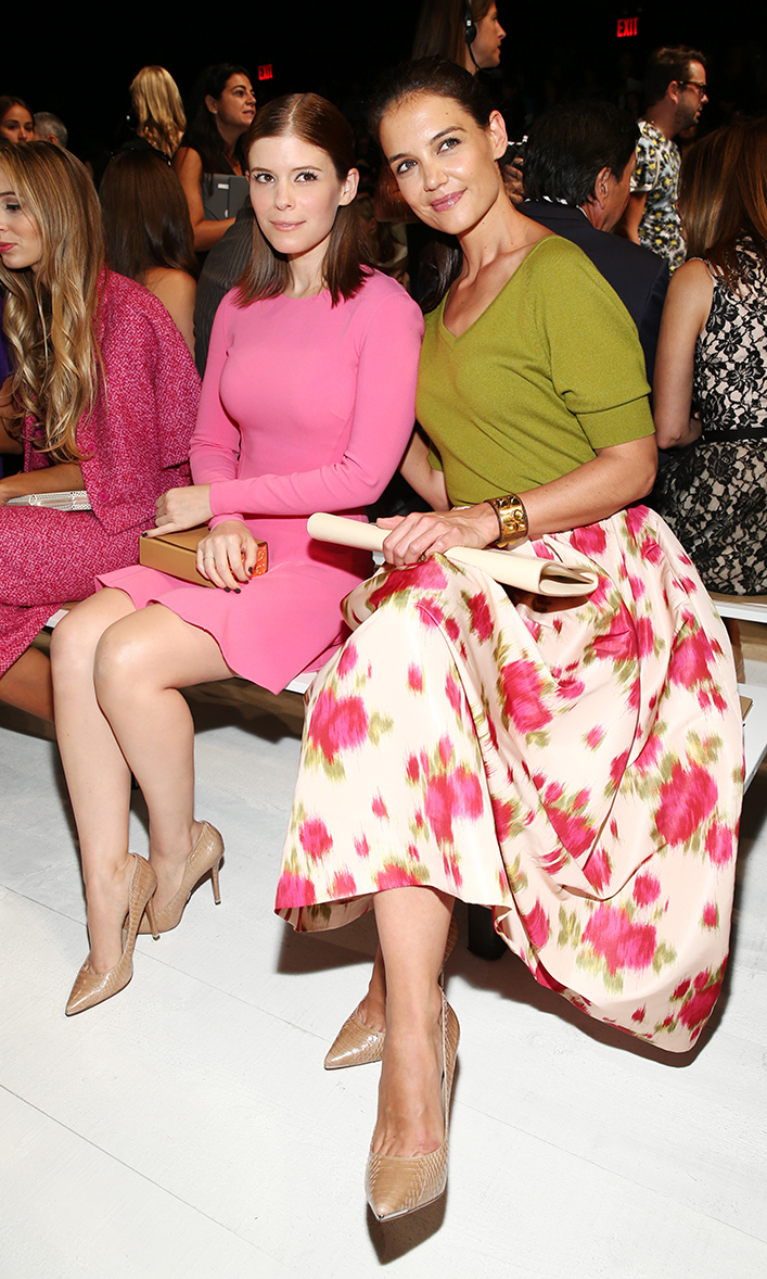 Actresses Kate Mara and Katie Holmes attend the Michael Kors fashion show during Mercedes-Benz Fashion Week Spring 2014 at The Theatre at Lincoln Center on September 11, 2013 in New York City.