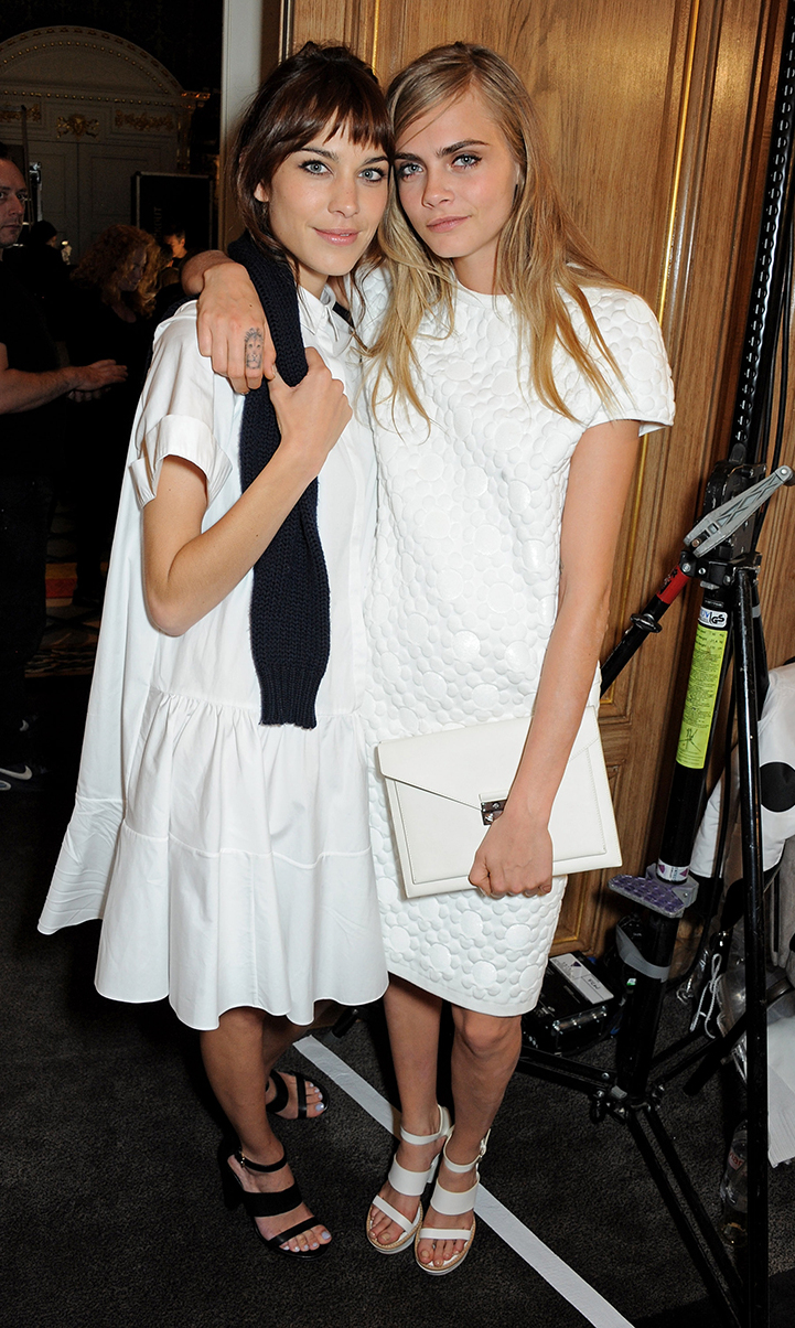 Alexa Chung (L) and Cara Delevingne pose backstage at the Mulberry Spring/Summer 2014 show during London Fashion Week at Claridges Hotel on September 15, 2013 in London, England.