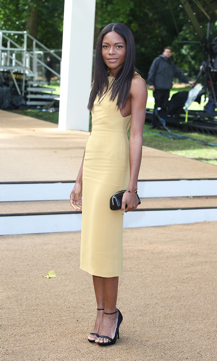 Naomi Harris attends the Burberry Prorsum show during London Fashion Week SS14 at Kensington Gardens on September 16, 2013 in London, England.