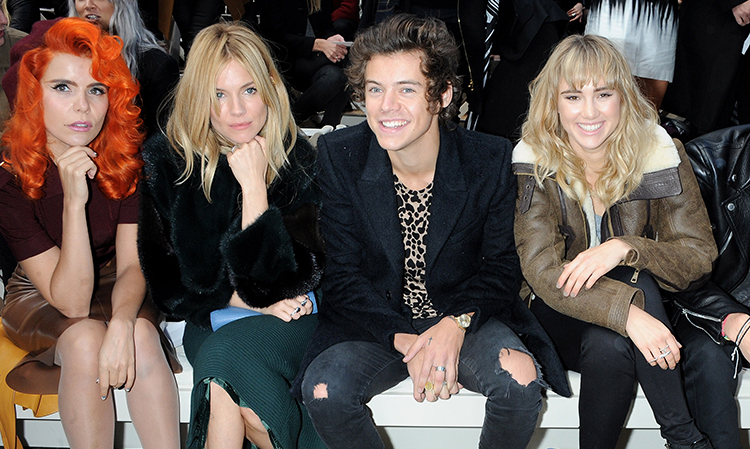 (L to R) Paloma Faith, Sienna Miller, Harry Styles and Suki Waterhouse attend the front row at Burberry Prorsum Womenswear Spring/Summer 2014 show during London Fashion Week at Kensington Gardens on September 16, 2013 in London, England.
