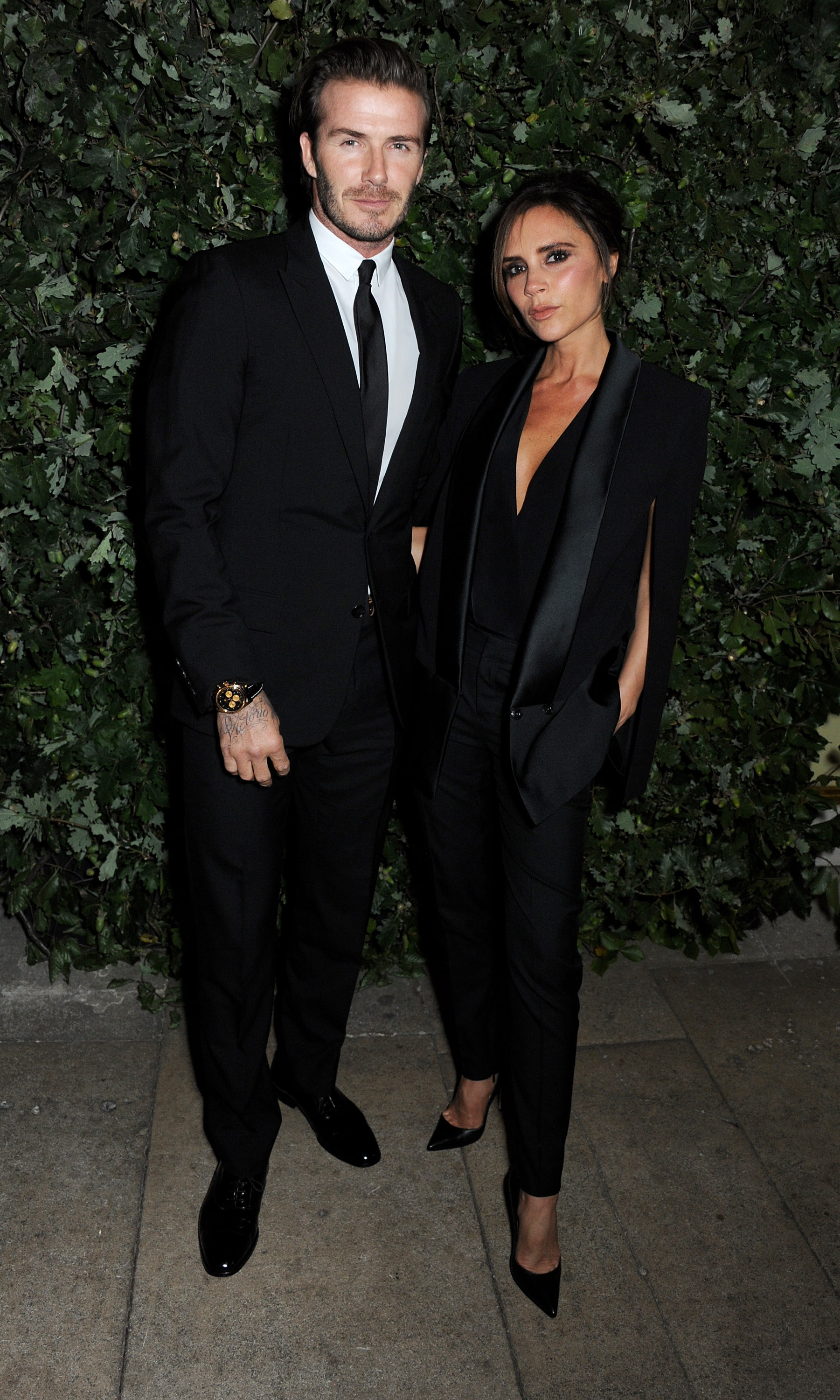 David and Victoria Beckham look sleek in matching black suits at the The Global Fund charity event hosted by Vogue US editor Anna Wintour.