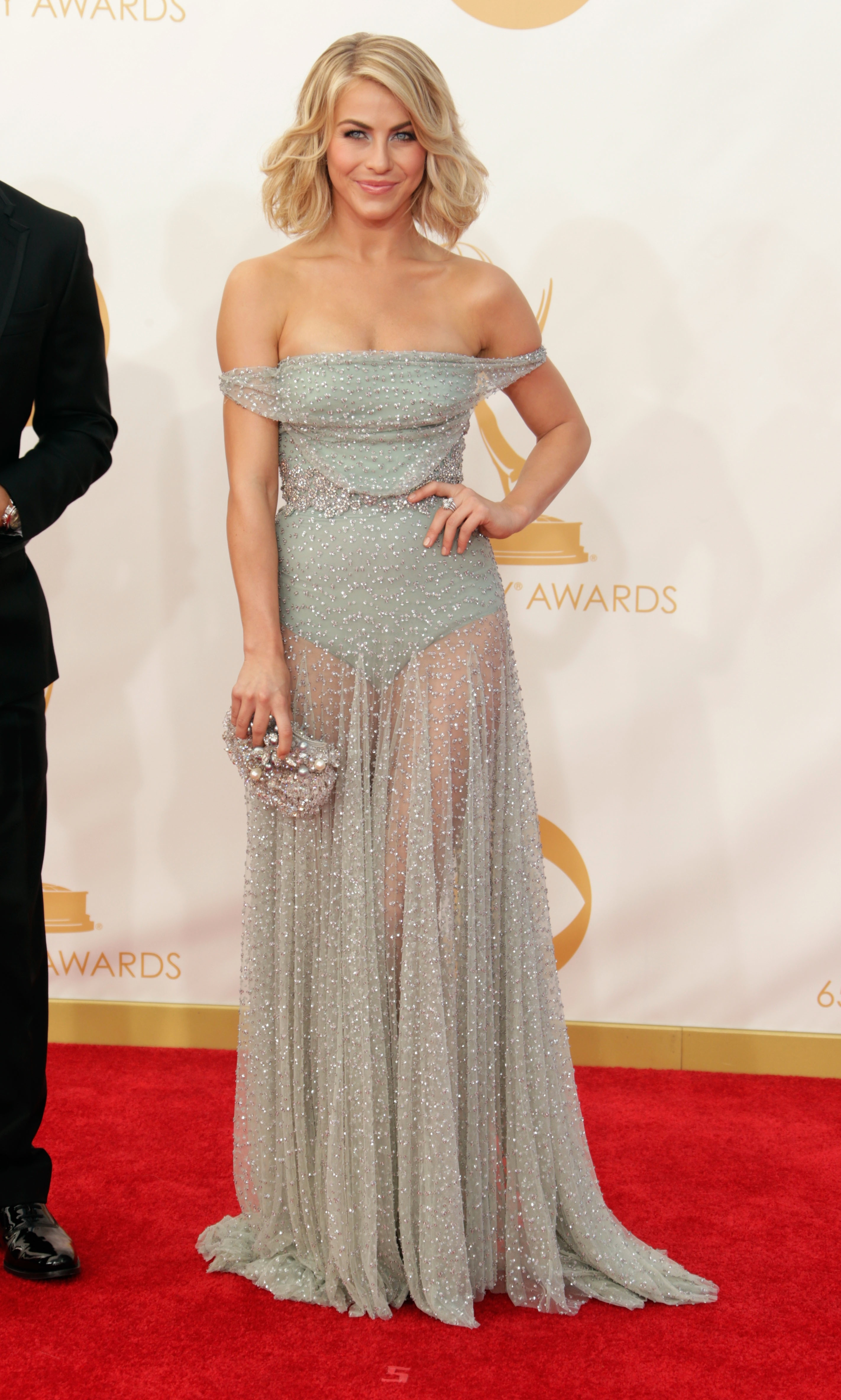 We've seen a lot of leg this past year in sheer skirts, but Julianne Hough's gauzy grey Jenny Packham gown feels fresh thanks to the delicate, off-shoulder detail.