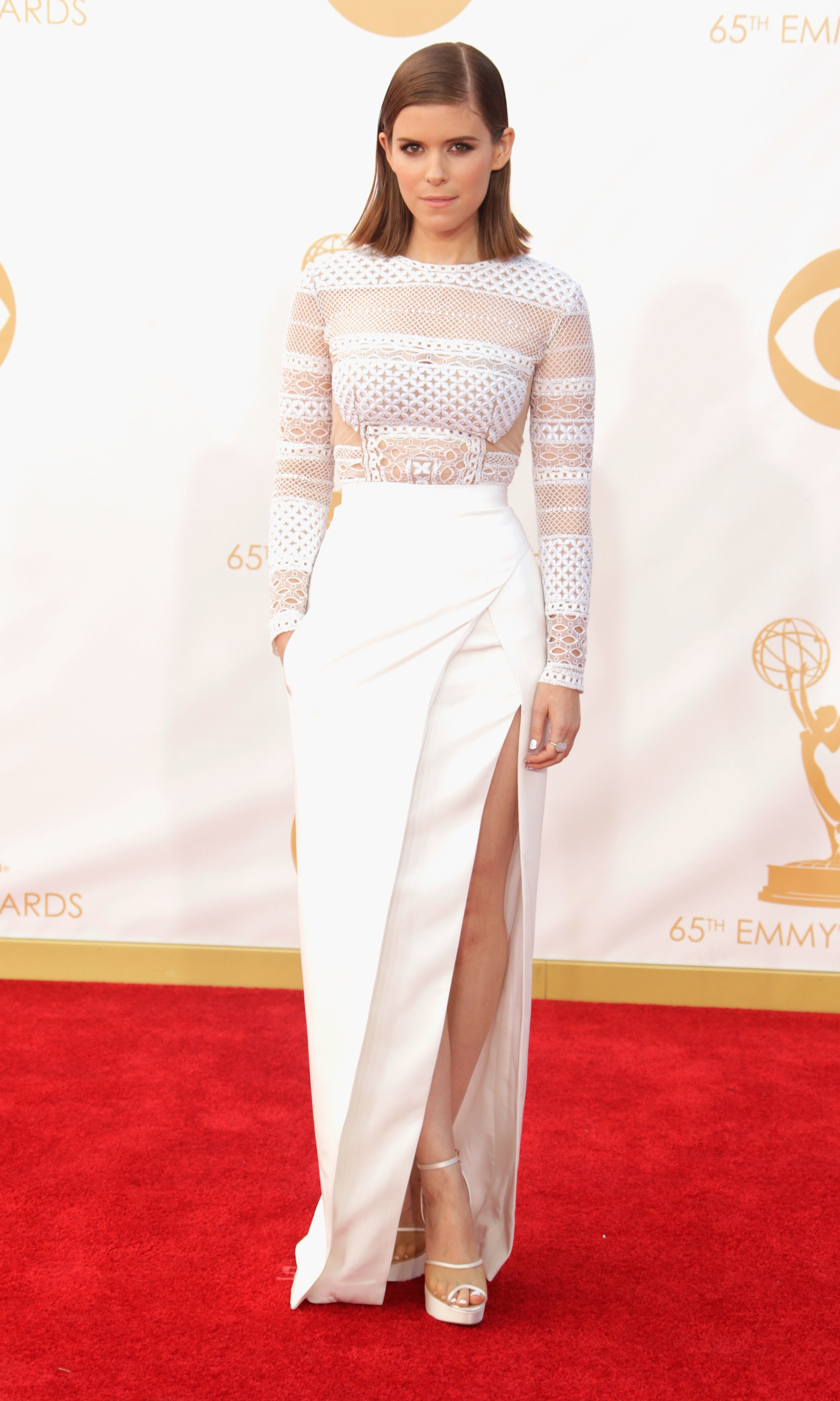 House of Cards star Kate Mara tends towards a basic t-shirt-and-jeans look on House of Cards, but she stepped it up for the Emmys in this fashion-forward J Mendel look. That slit, though?
