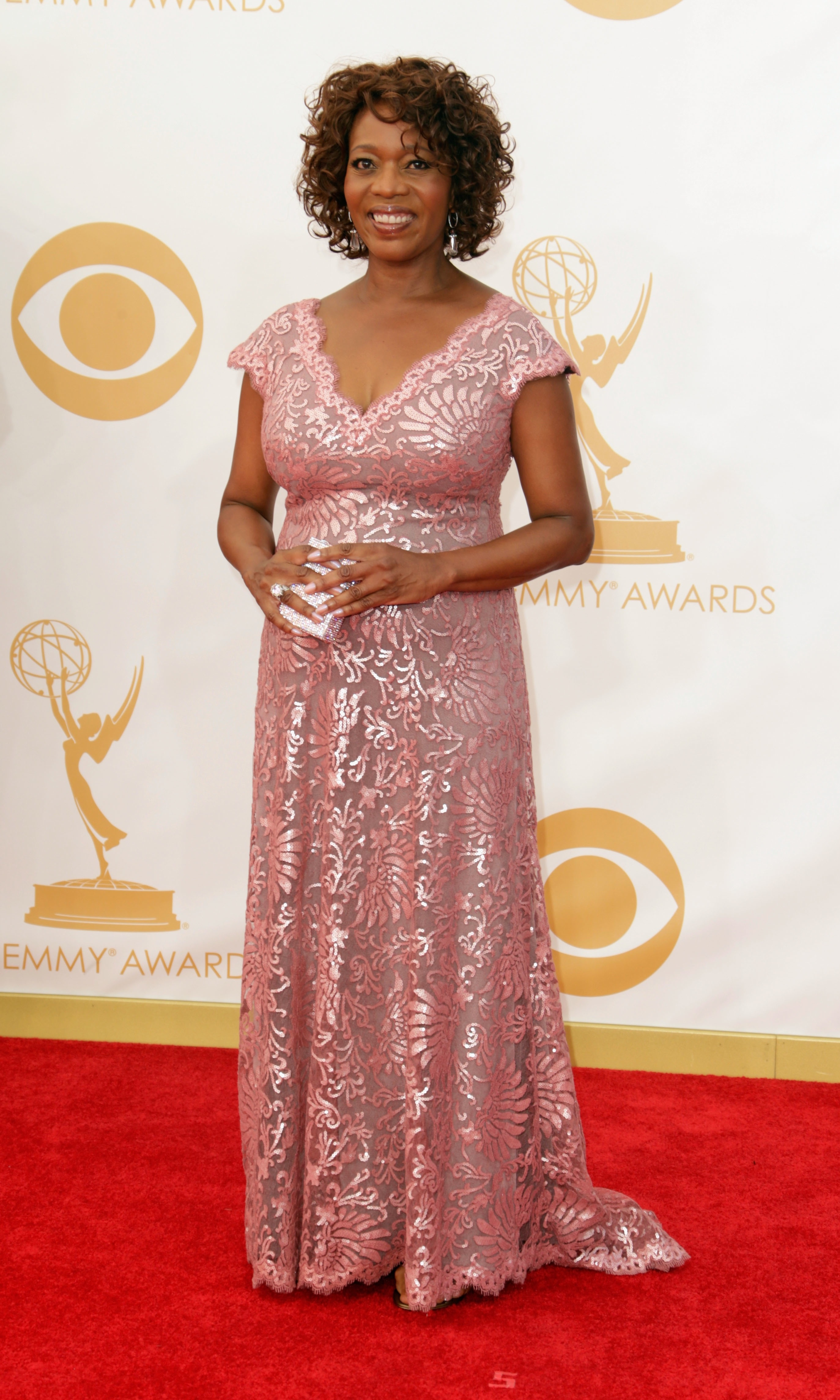 Emmy Award-nominee Alfre Woodard chose pale pink and limited accessories to let the finish shine in this stunning, lacy number.