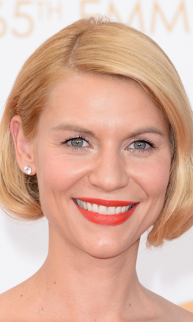 Claire Danes surprised everyone at the Emmys with a new 'do, but as she explained to E! red carpet commentator Ryan Seacrest, her new look was thanks to a 'faux bob.' Either way, we think she looks incredibly glam!