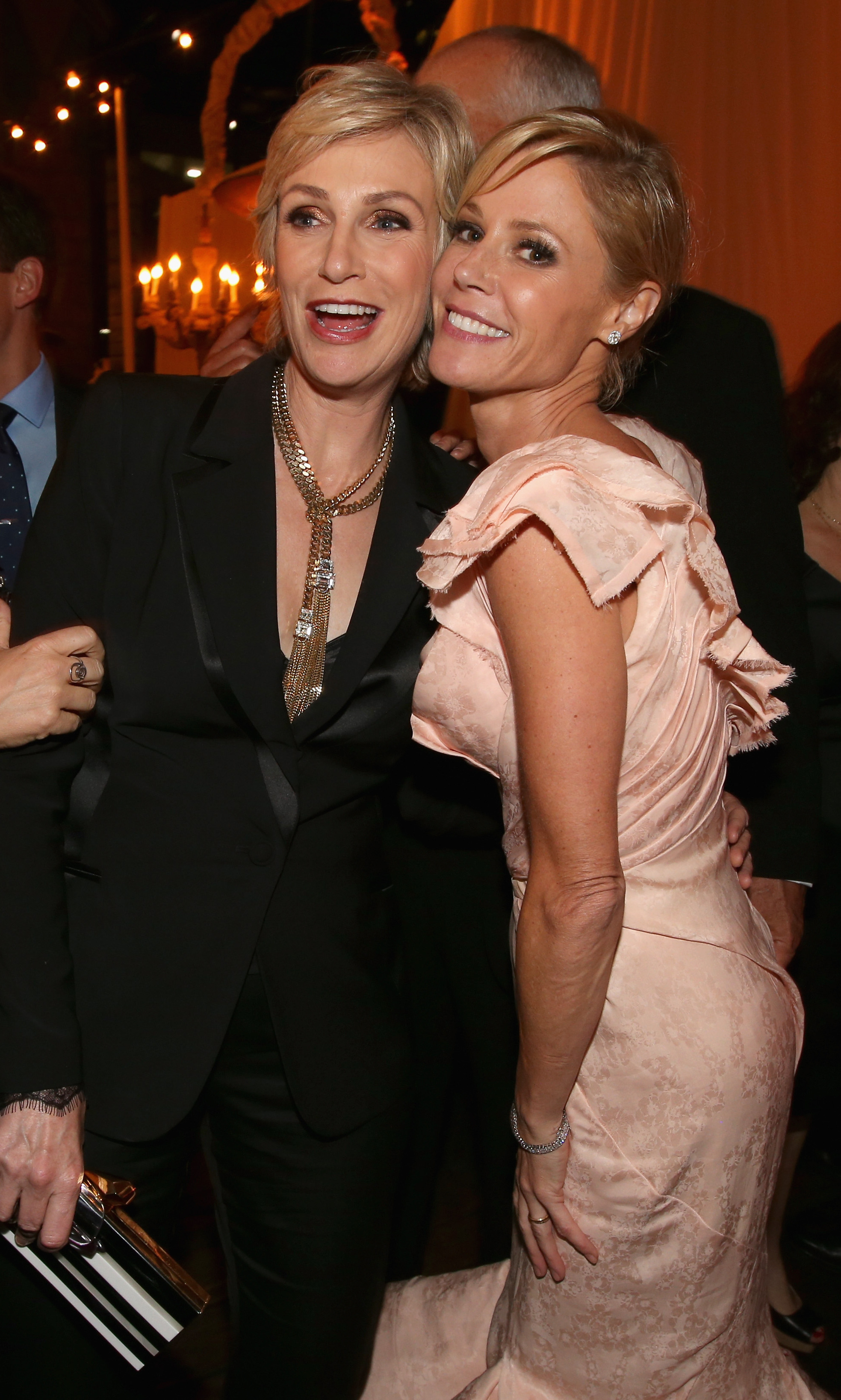Glee actress Jane Lynch catches up with Modern Family star Julie Bowen at the post-Emmy party at Fox.