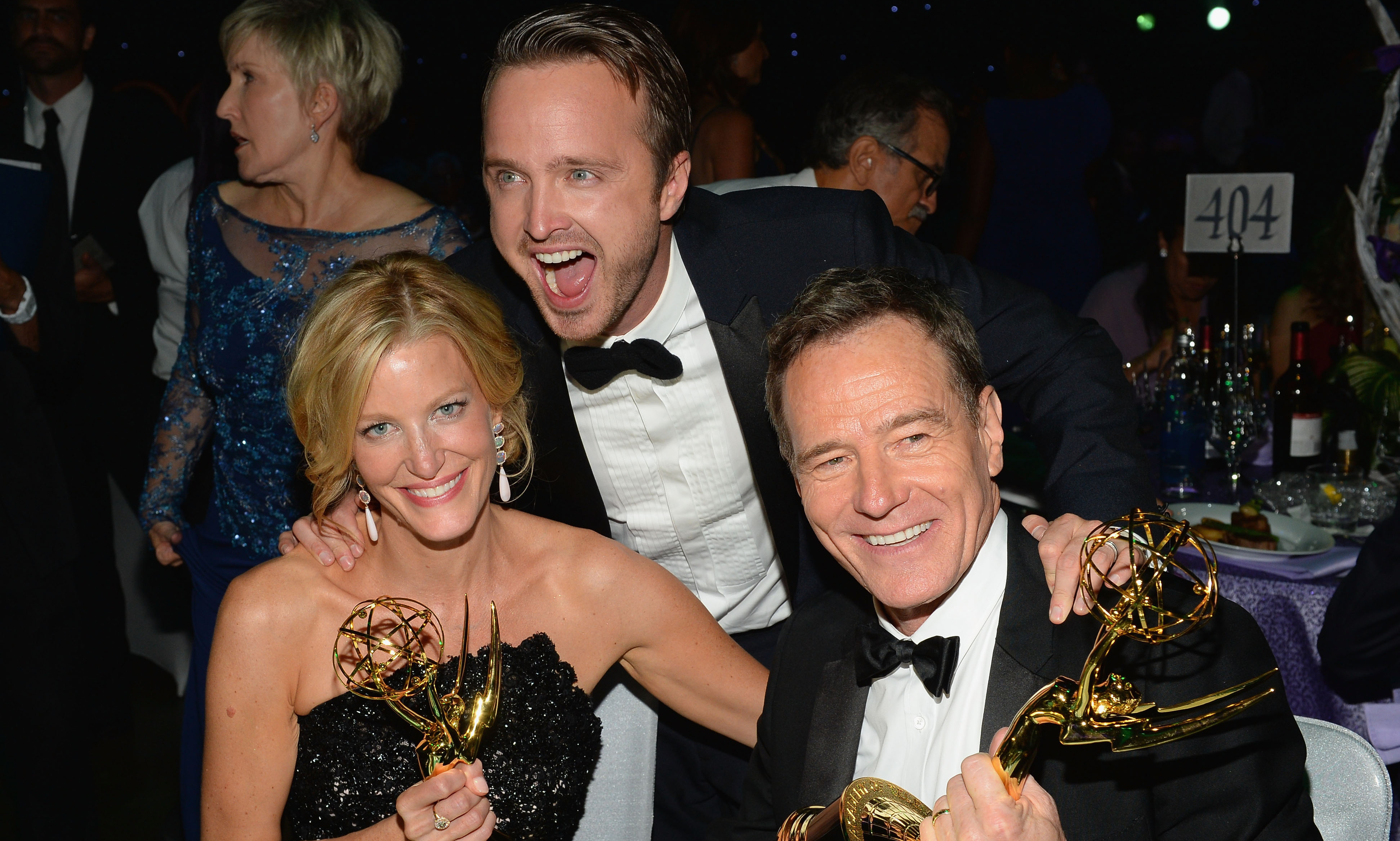 Breaking Bad stars Anna Gunn, Aaron Paul, and Bryan Cranston celebrate the show's win at the Governors Ball during the 65th Annual Primetime Emmy Awards.