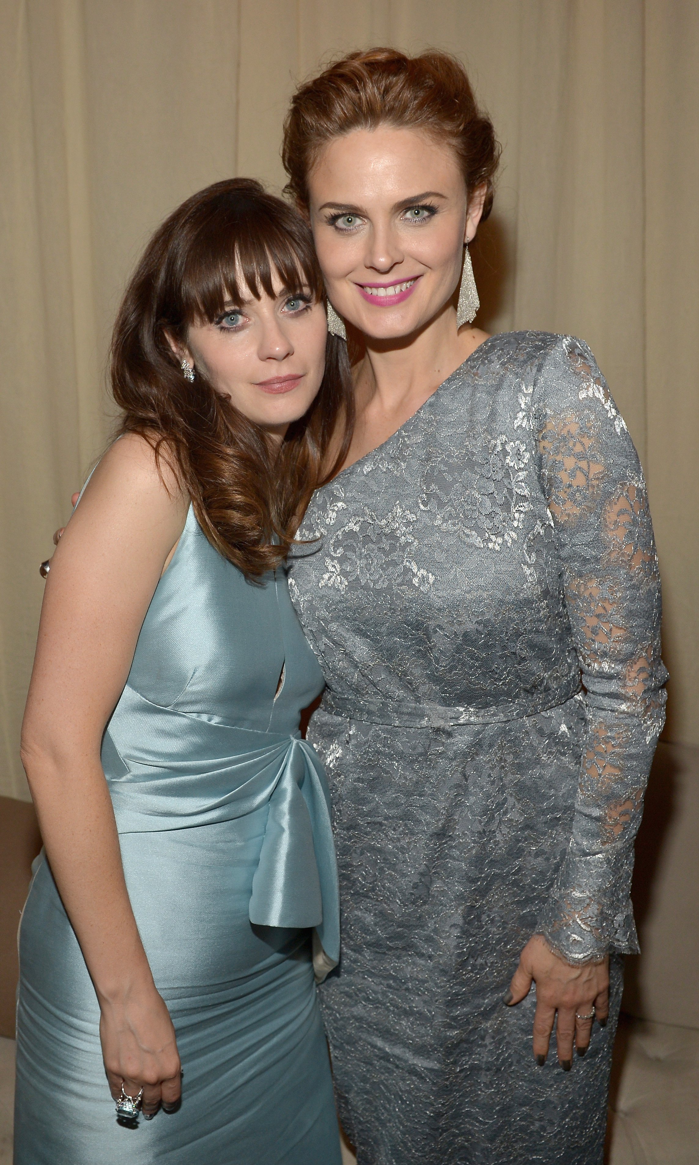Zooey and Emily Deschanel show some sisterly love at the Fox party.