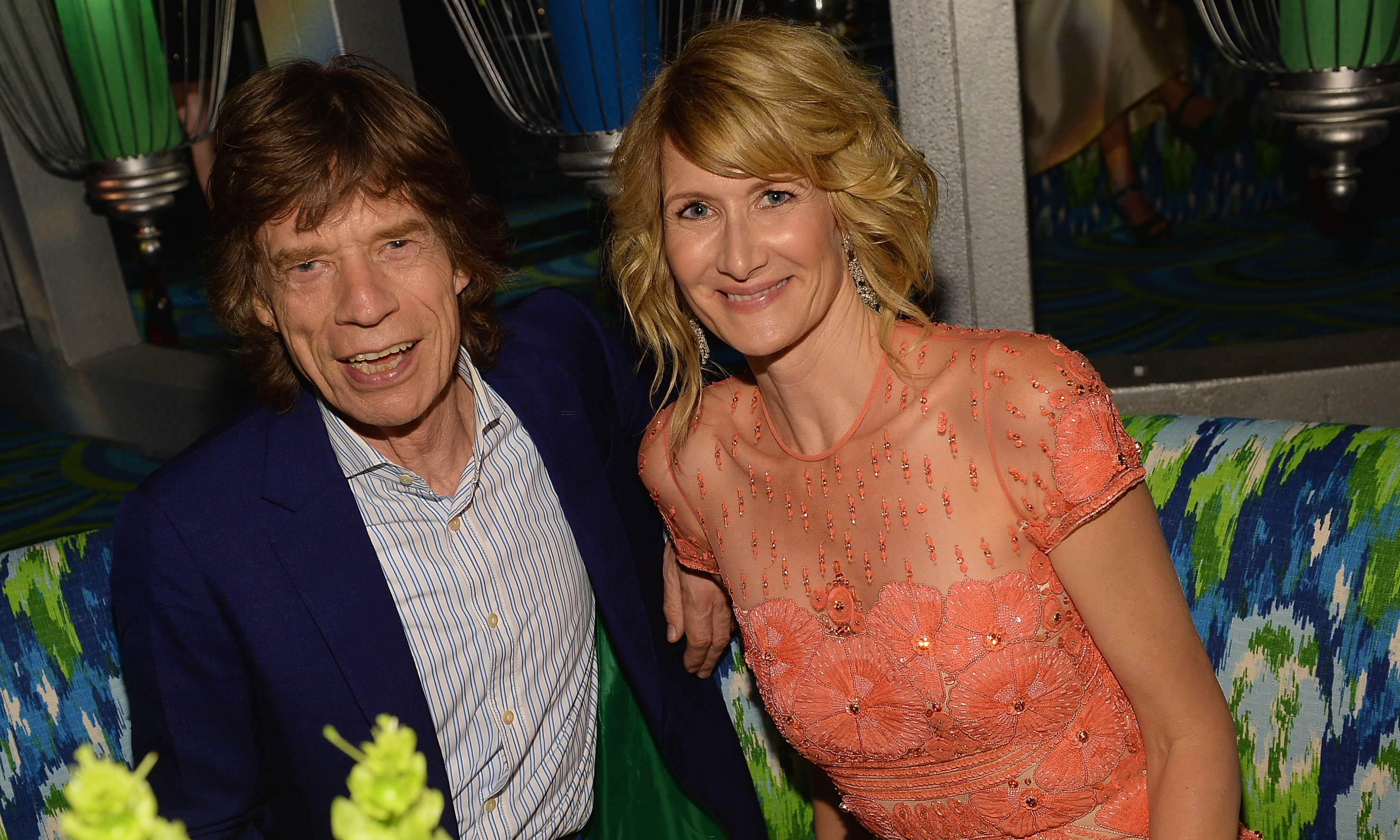 Great-grandfather-to-be Mick Jagger chats with Enlightened actress Laura Dern at the HBO after-party.