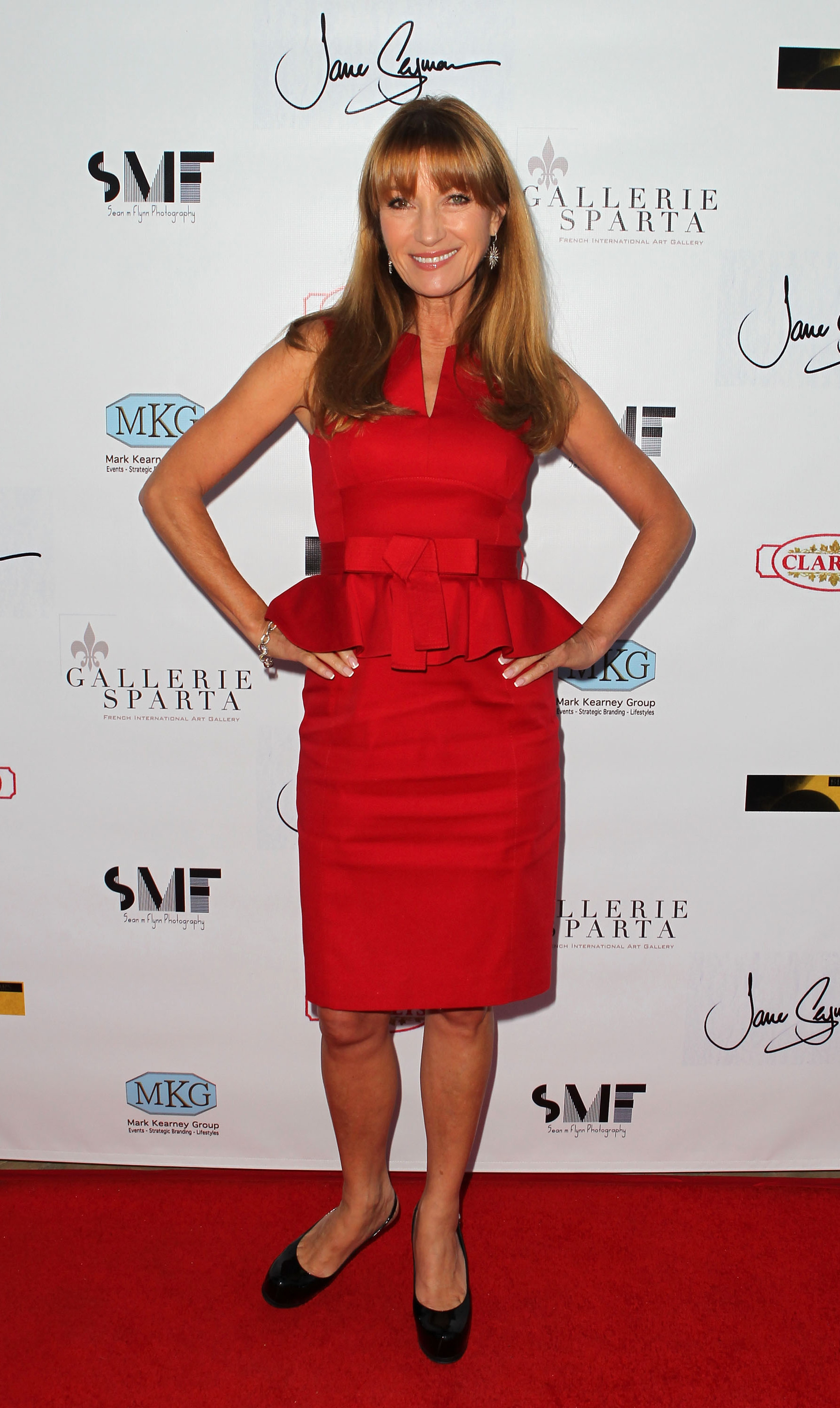 The former bond girl looked ravishing a figure-hugging, red peplum dress.