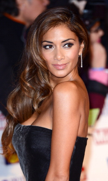 Nicole Scherzinger looked flawless at the Pride Of Britain Awards on Monday night, rocking big, bouncy curls and a golden tan.
