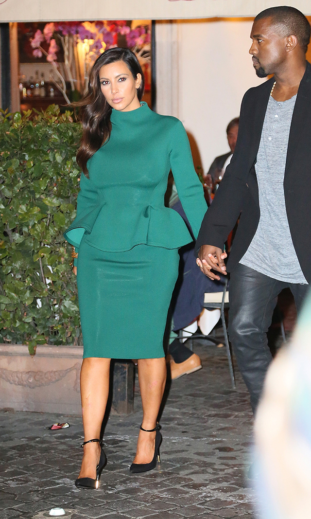Accompanied by her main man Kanye West, Kim hits up the Piazza Del Popolo in style on Oct. 18, 2012, wearing a jade peplum dress that hugs her curves in all the right places.