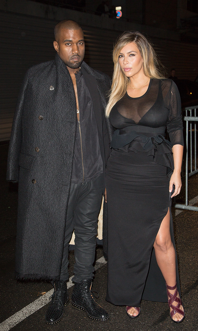 "On Sept. 29, new parents Kim and Kanye attend the Givenchy show in Paris, once again looking matchy-matchy in their all-black ensembles. It looks like they've been practicing their ""smize"" (smile with your eyes) together!"
