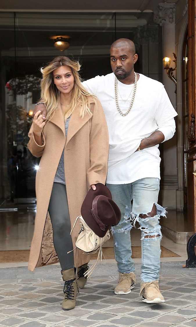 New baby, new 'do! Wearing dressed-down and coordinating outfits, Kim and Kanye are all smiles in a post-baby appearance on Sept. 28 in Paris. Kim looks like she's already slimmed down considerably since giving birth to baby North West on June 15.